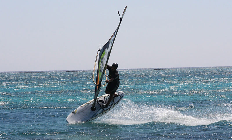 Wind surfing in the pink blue waters of Elafonisi beach